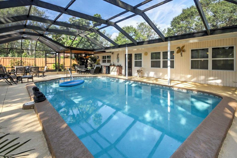 Let your worries fade away as you lounge by your private pool at this home!
