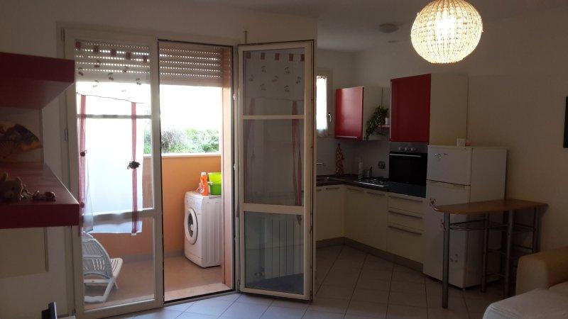cocina y balcón