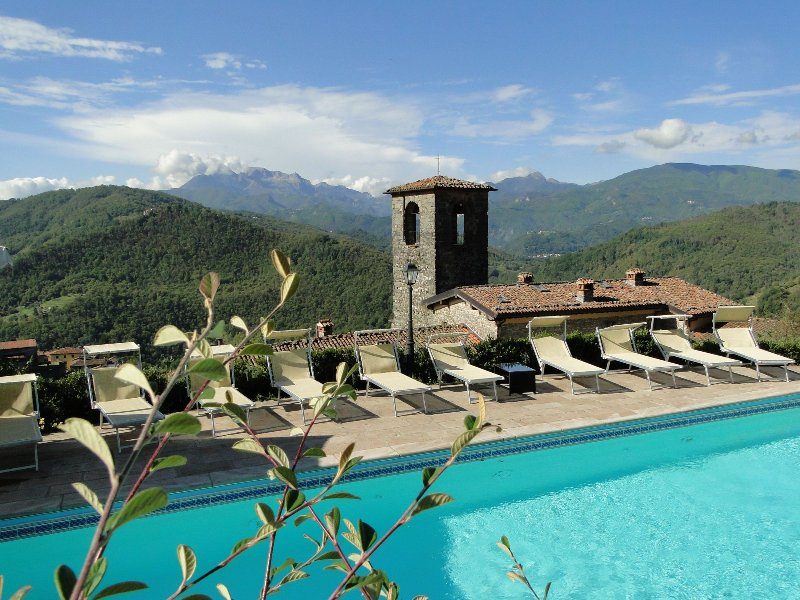 Your own piece of pool paradise, surrounded by mountains, with your own monastery below!