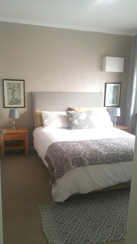 Comfortable bedroom with built in cupboards.