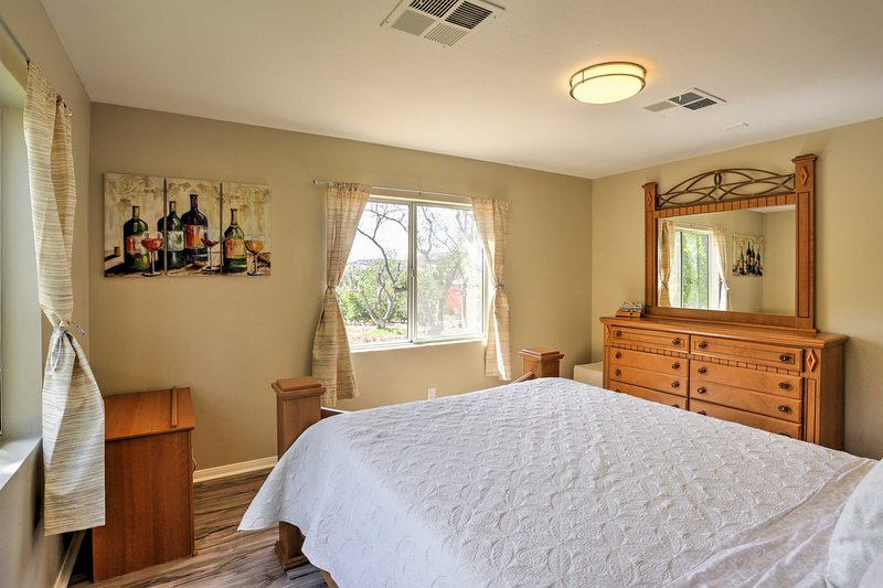 Natural windows flood this bedroom with warm, natural light.