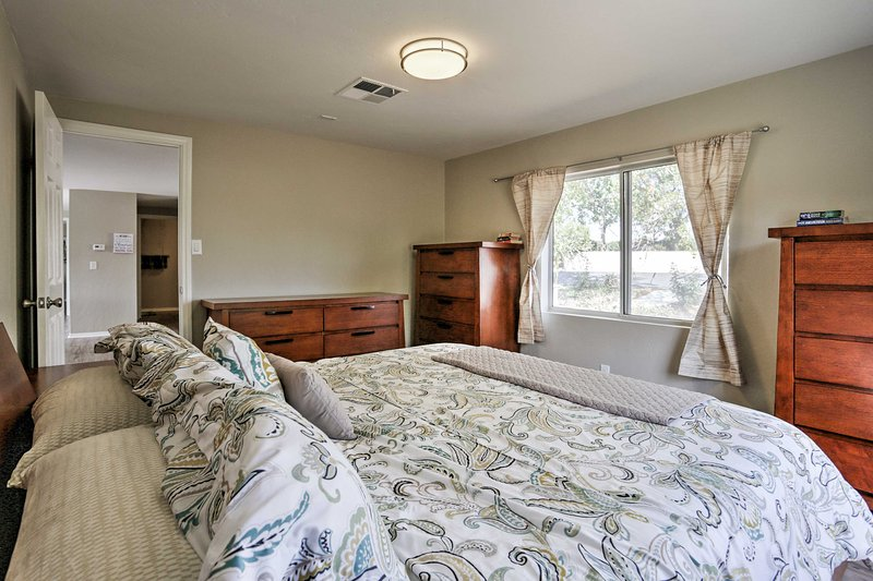 This bedroom boasts a king-sized bed and plenty of storage space.