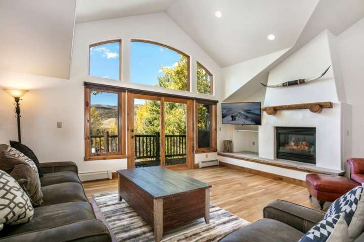 Curl up on the sofa to enjoy the gas fireplace and a movie in this bright sunny living room.