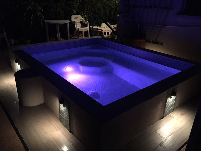 Fully tiled pool with atmospheric lighting and step lighting.