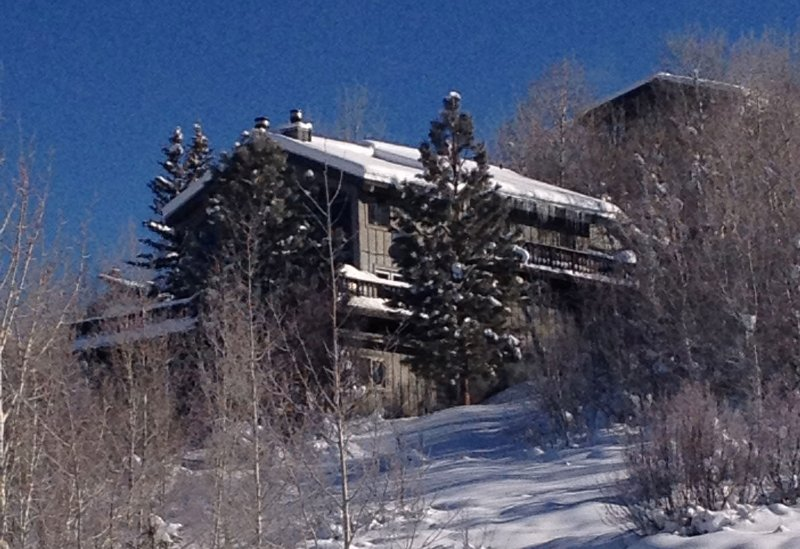 This private, multi-level home is in easy walking distance of the ski area base