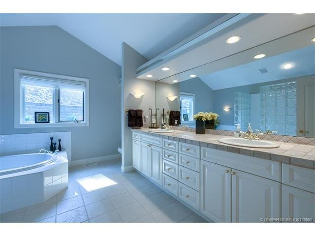Master bath with walk-in shower and oversize tub plus double sinks.