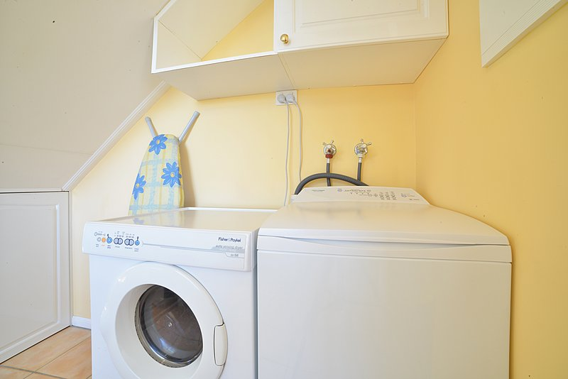 Australian cottage private laundry in kitchen area