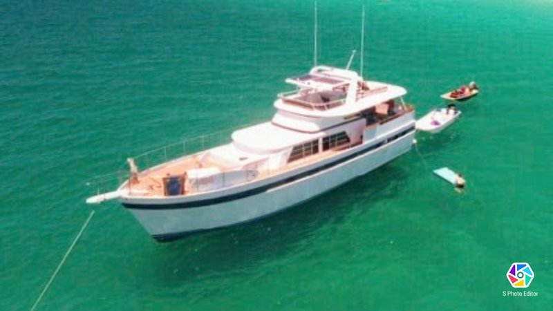 Joy Ride anchored for private off shore charter