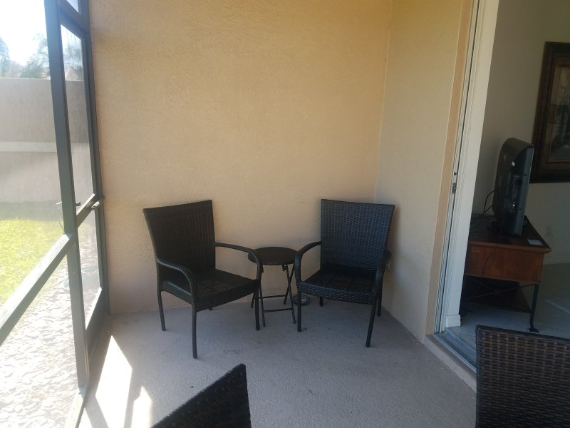 2 extra chairs with table on screened porch