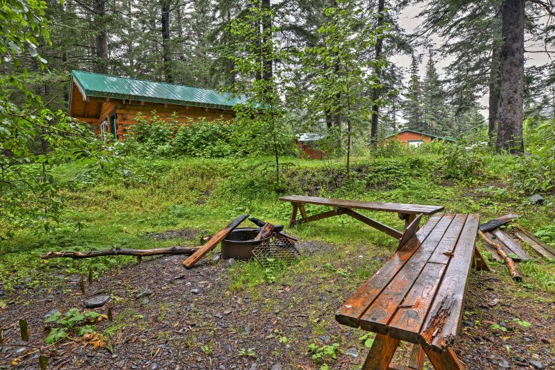 The cabin sits on 3 acres of wooded land for a peaceful Seward getaway.