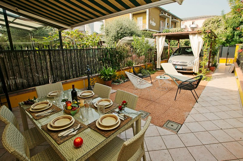 Outdoor dining for six people and private covered parking
