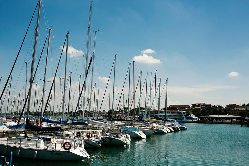 Regular ferries from Desenzano port to visit the whole lake