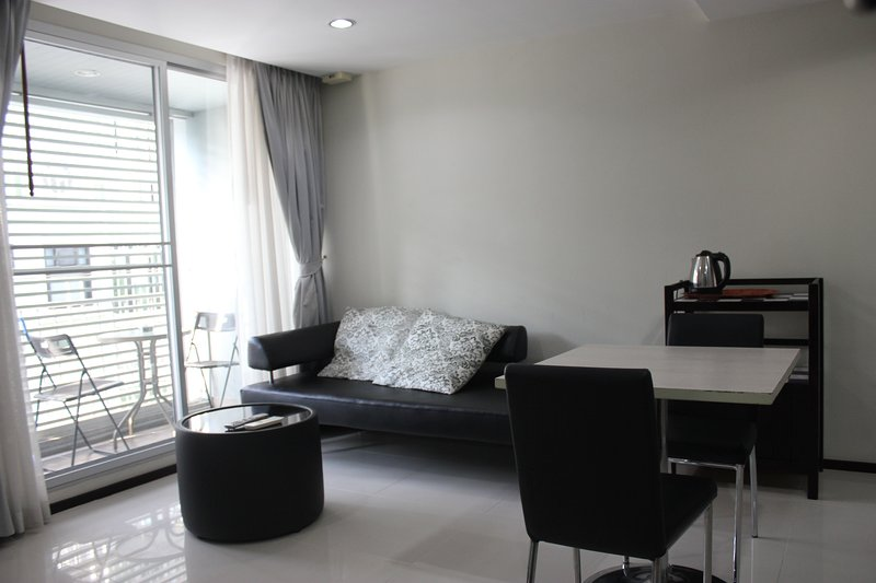 Living and dining area. There is a small terrace outside