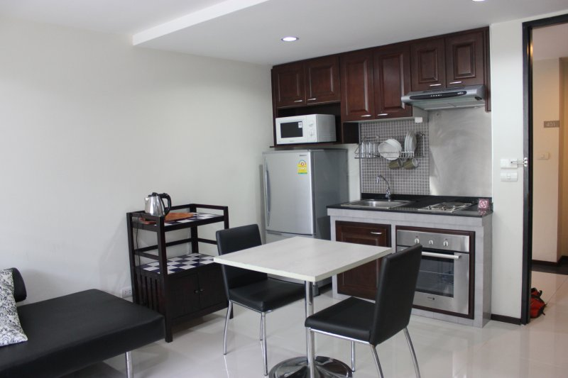 Kitchen with stove, oven, microwave, fridge, and small appliances in addition to all the plateware y