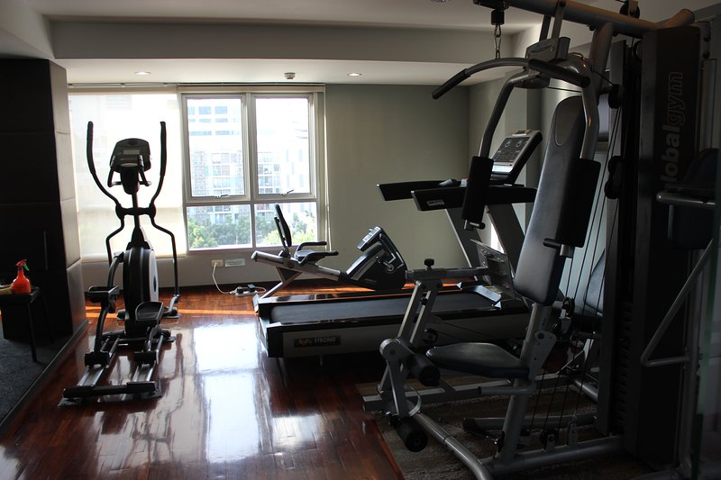 Sufficient gym equipment for a good workout.