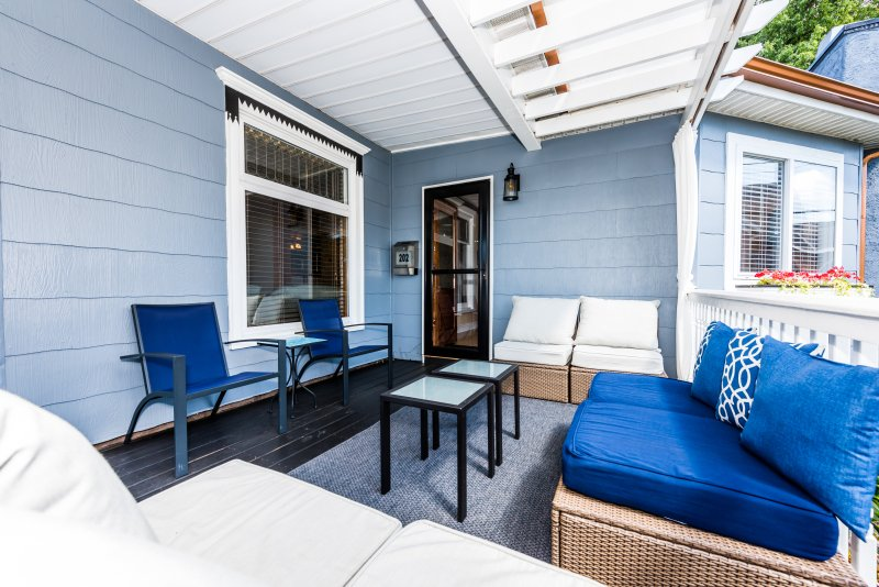 Outdoor lounge on our covered porch has easy access to the gourmet kitchen.