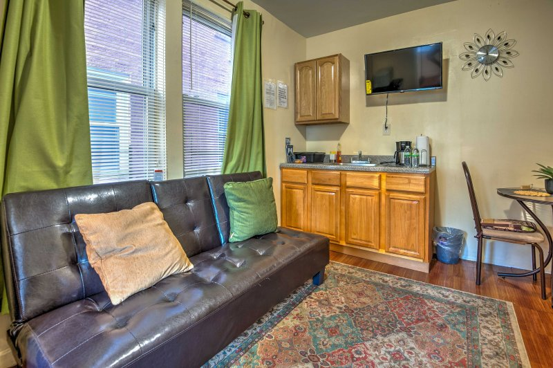 Warm and inviting, this quiet apartment is the perfect place to relax after a day out in the bustling city.