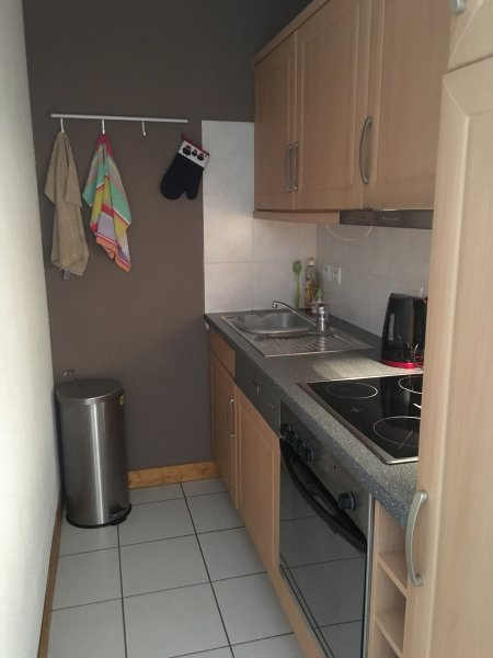 The galley style kitchen with dishwasher, cooker and hob, fridge freezer, cutlery and crockery.