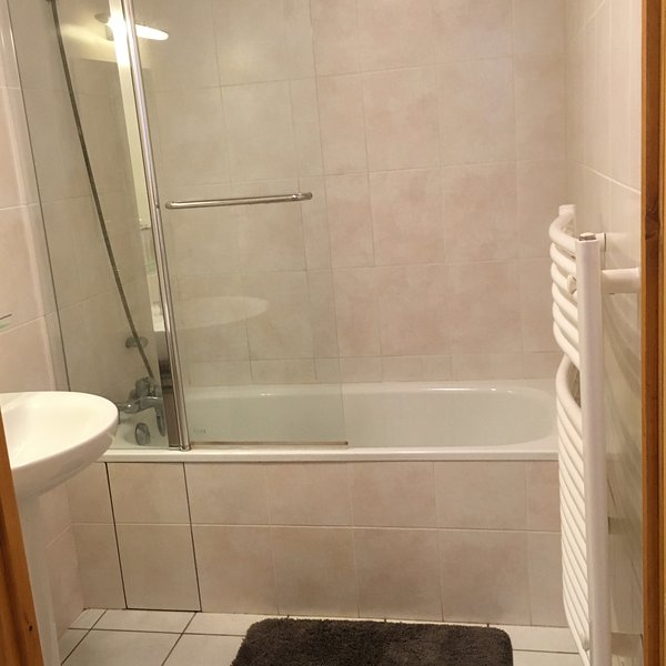Bathroom with shower/bath and sink. Toilet is separate.
