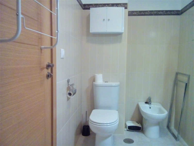 large bathroom with toilet and bidet.