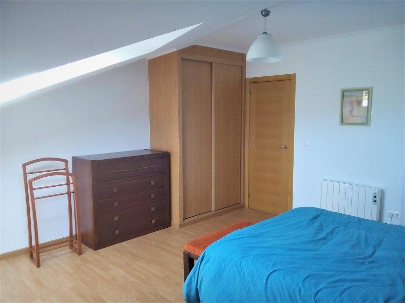 impotrado and comfortable large attic bedroom closet.