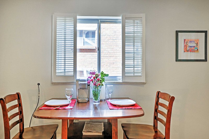 Enjoy a romantic, candlelit dinner with your loved one at this 2-person dining table.