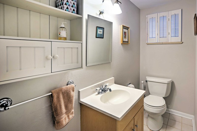 Freshen up after an adventure-filled day in this full bathroom.