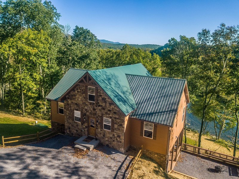Brand new river-front cabin with ridiculous views and open spaces!
