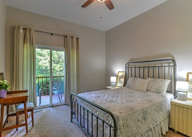 Bedroom with a queen bed and accessibility to back deck.