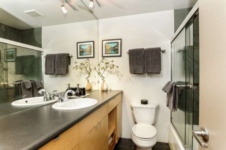You will enjoy getting ready for your day in this contemporary full bathroom with tub and shower