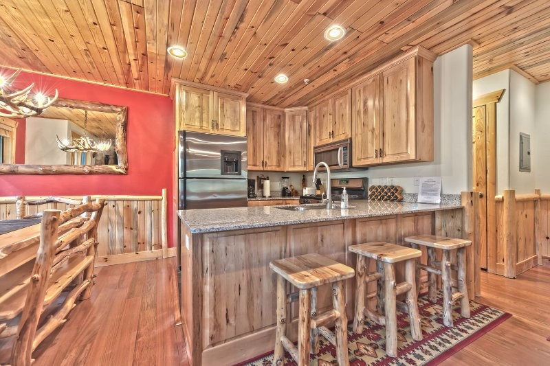 Fully Equipped Kitchen with Granite Counters, Stainless Steel Appliances, Bar seating for 3