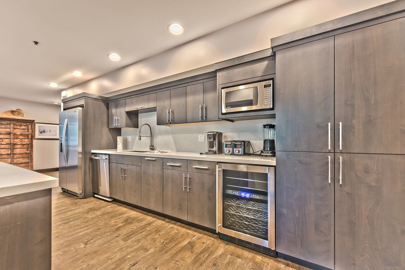 Newly Renovated Gourmet Kitchen with New Stainless Steel Appliances, a Large Island, Quartz Countertops and a Wine Fridge
