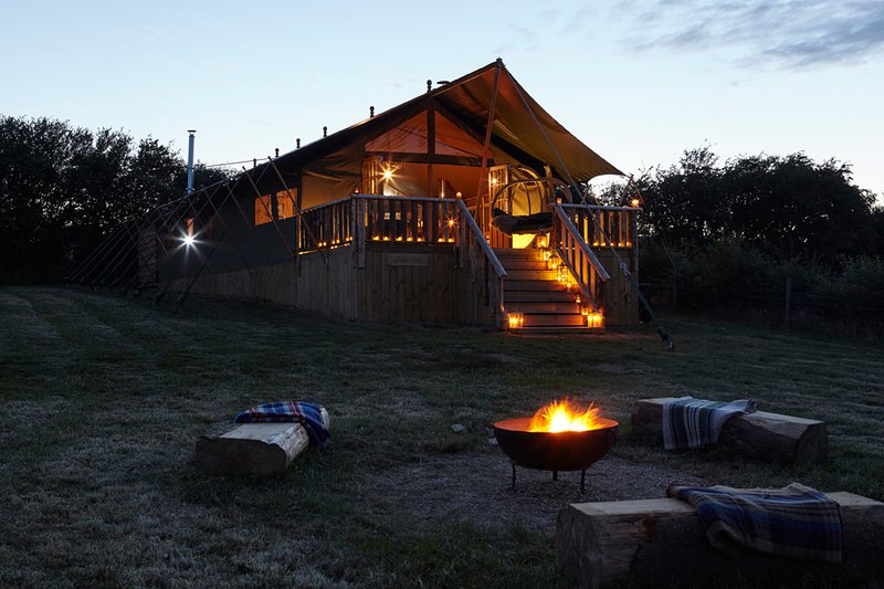 Cosy comfort by lamp light. Feel the warm glow of the camp fire.