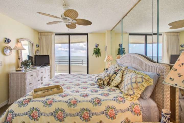 Master bedroom features king size bed, fan, flat screen TV and ocean views!