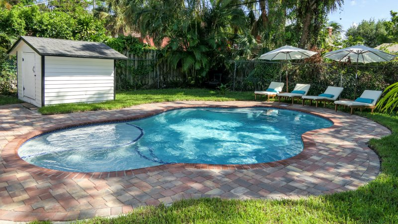 Lagoon shaped pool and spacious pool for year round swimming, grilling and entertainment.