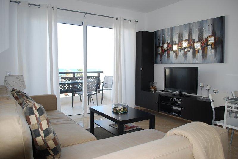 Apartment Los Arcos. Sun, relax y beach, aluguéis de temporada em Puerto Del Carmen