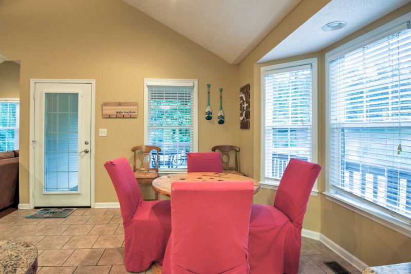 Gather around the 4-person dining table each night to savor home-cooked meals.