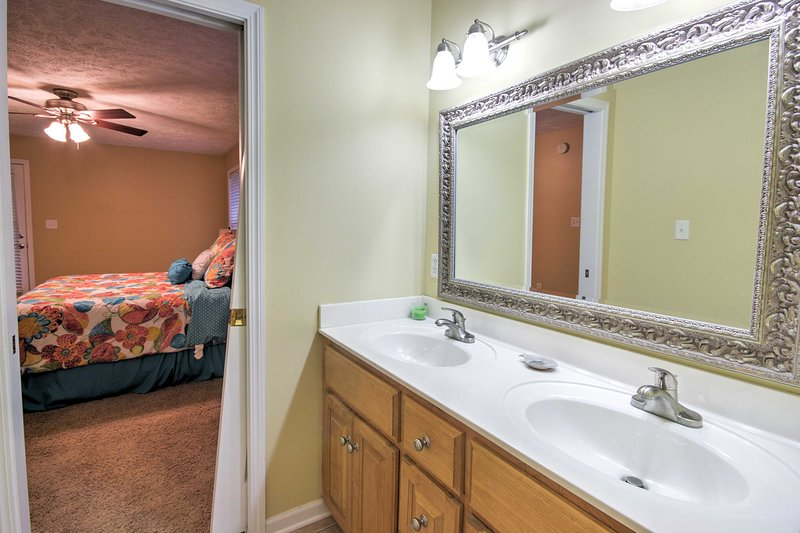 The master en-suite bathroom has a shower/tub combo and Jack-and-Jill vanity.