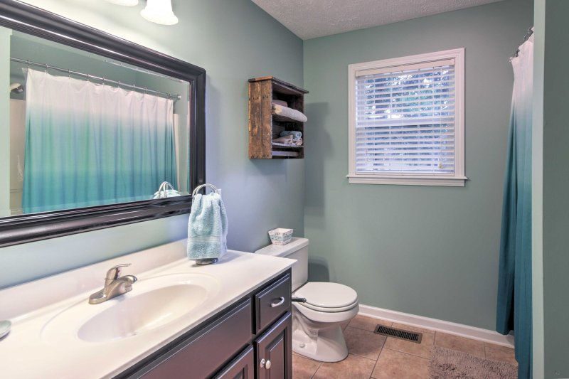 Wash up in the single vanity and shower/tub combo found in the second bathroom.