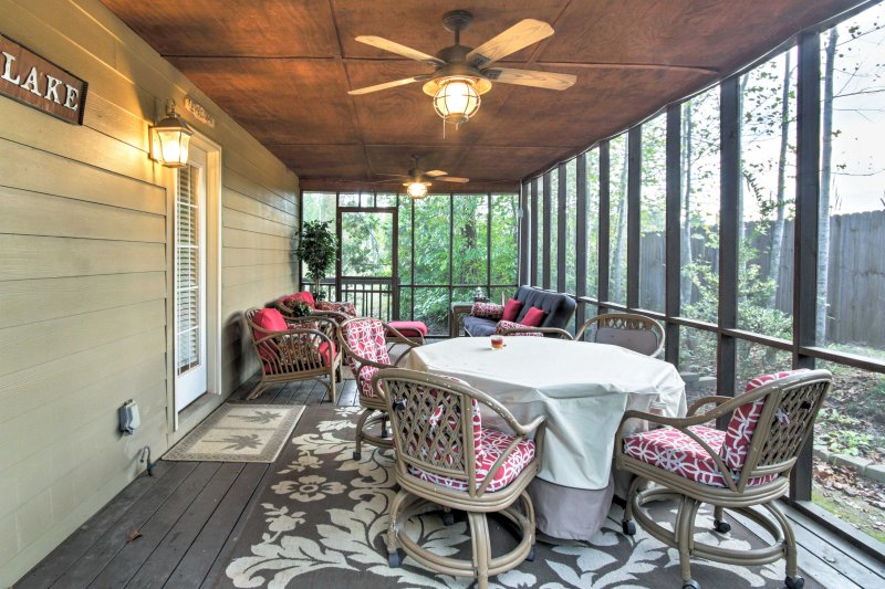Play a round of cards on the 4-person gaming table on the porch.