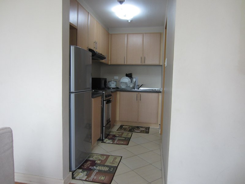 Kitchen with full kitchen and dining wares