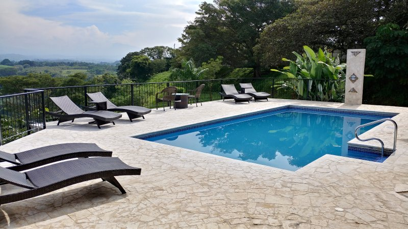 Relax on the beautiful coralina stone terrace at Villa Serenidad.