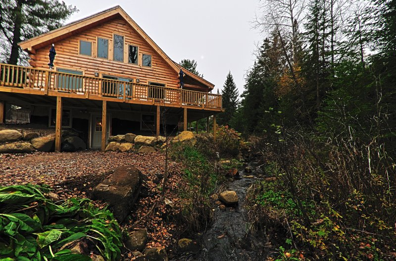 A creek next to the log home