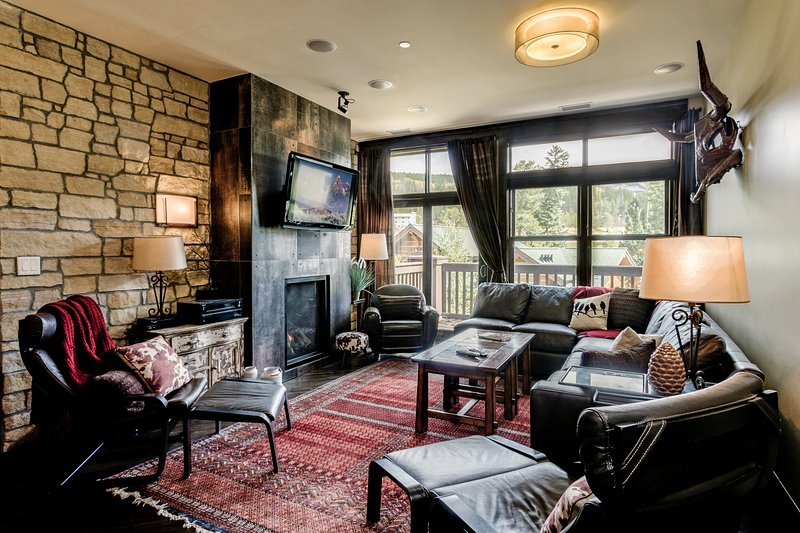 Cozy up in the living room with gas fireplace and flat screen TV