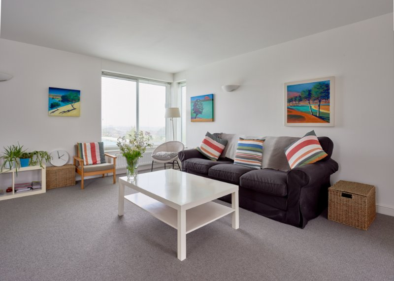 Spacious open plan living room with far distant views of the beautiful Cotswold Hills and beyond.