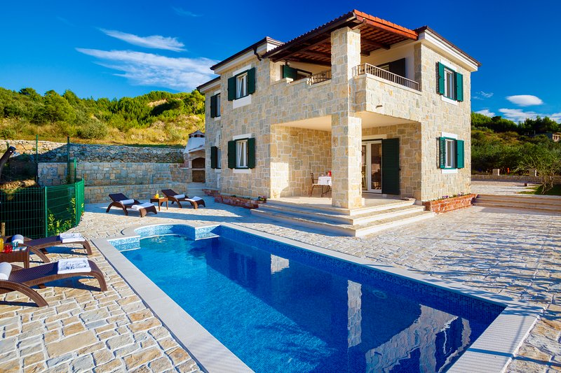 Villa made completely from local stone is surrounded by a private pool, outside BBQ, olive trees...
