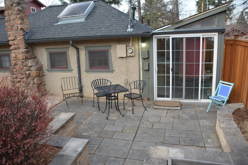 Private patio for cottage guests just outside kitchen sliding door, with views of the Flatirons.