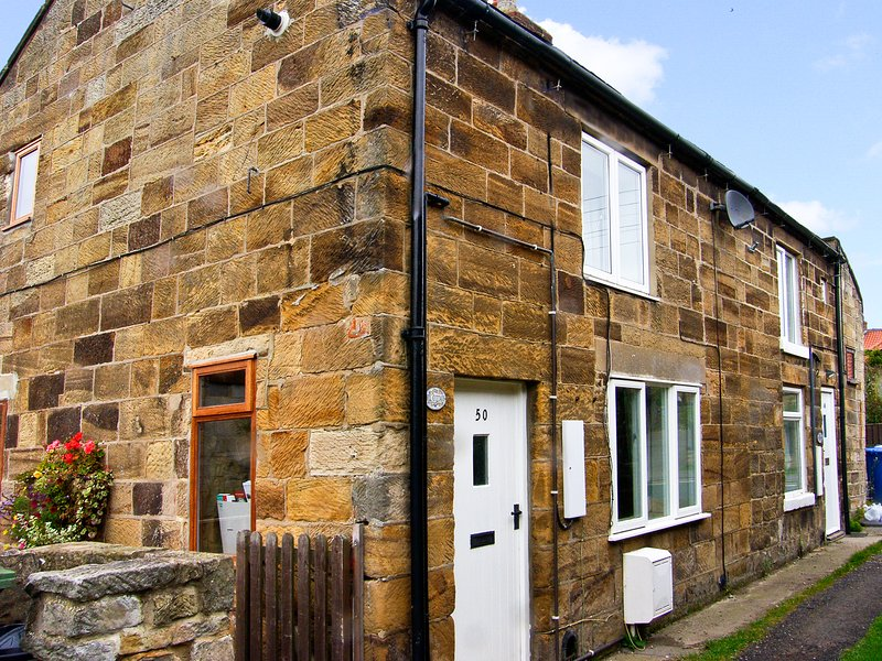 MILL COTTAGE, pet friendly, character holiday cottage, with open fire in, vacation rental in Staithes