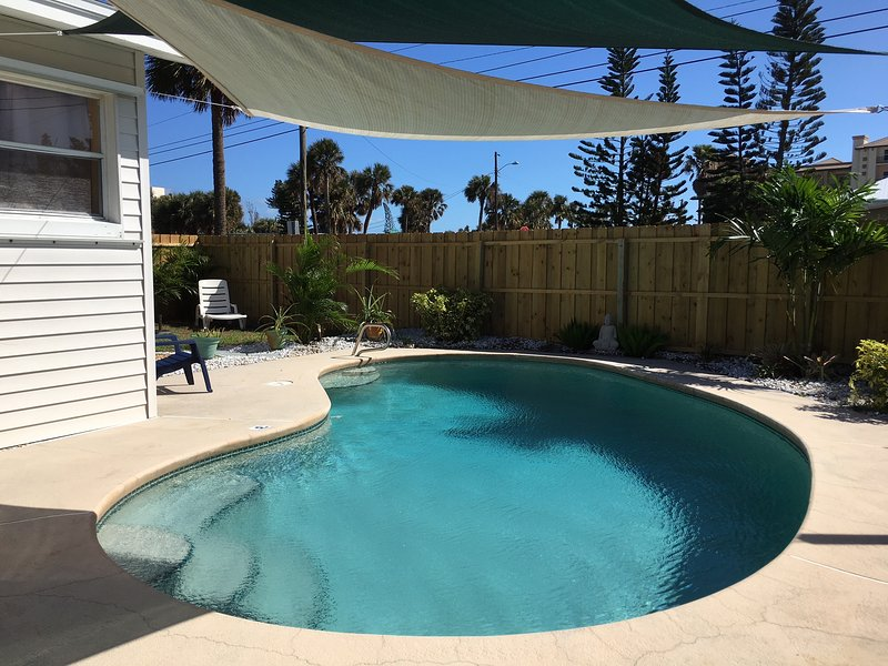 Private Heated Pool is in a fully fenced garden, right next to your Beach House!