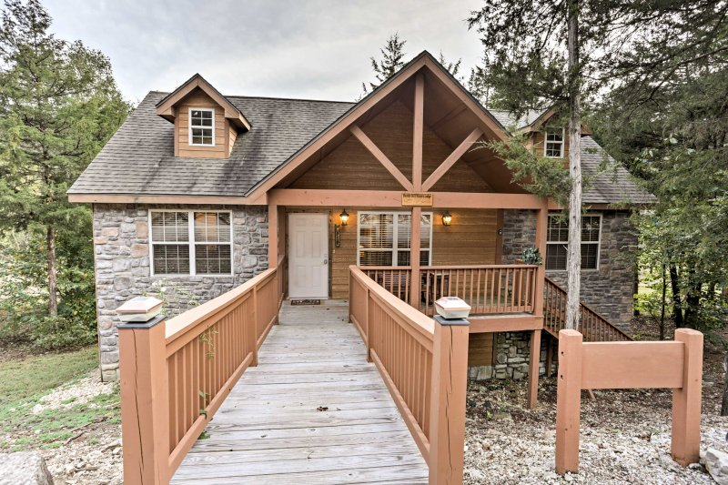 The cabin is located at the end of a quiet street in a serene, wooded area.